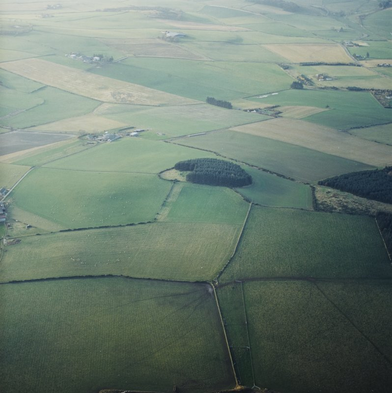 General oblique aerial view centred on the remains of the recumbent stone circle with the farmsteading adjacent, taken from the E.