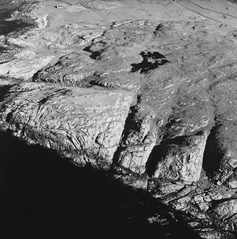 Oblique aerial view of Dun Dubh centred on the remains of a fort, taken from the W.