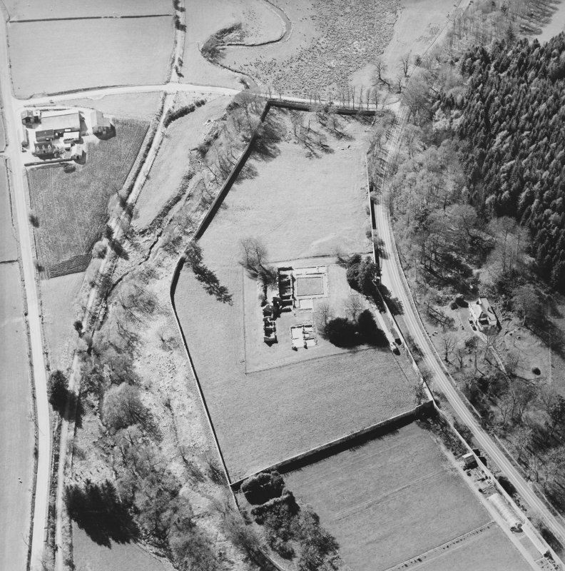 Oblique aerial view centred on the remains of the abbey and the house, farmhouse and farmsteading, taken from the ESE.
