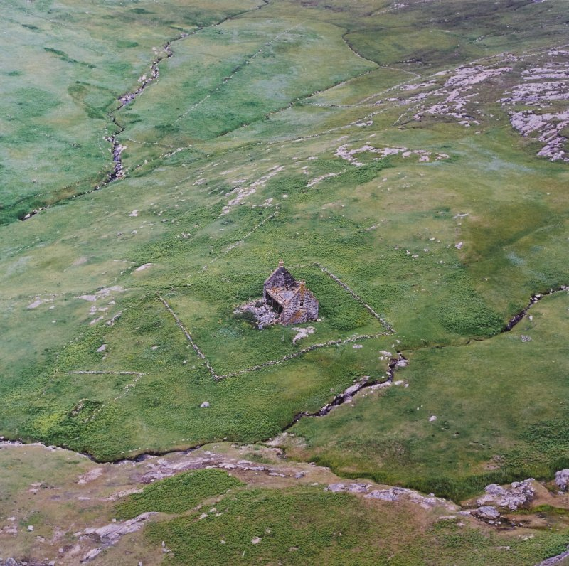 Oblique aerial view centred on the remains of the chapel house and enclosure, taken from the NW.