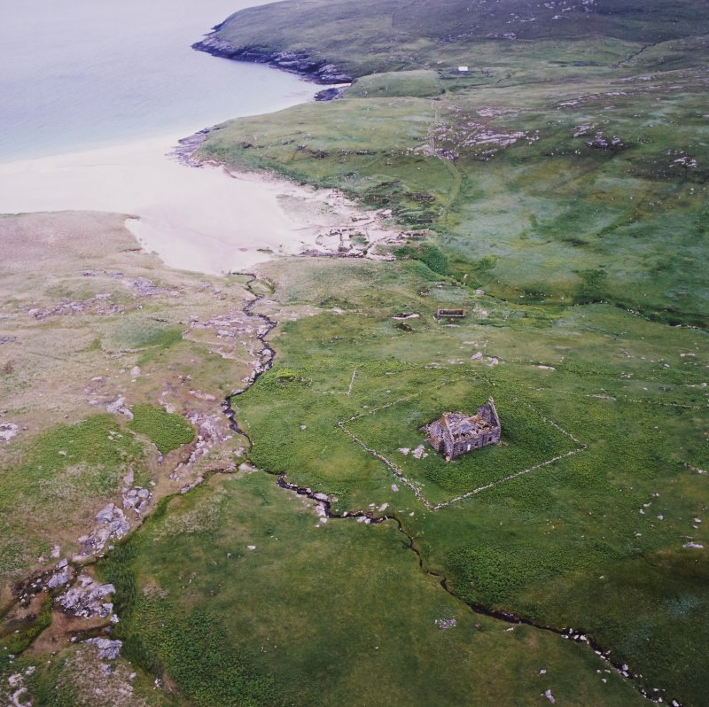 General oblique aerial view centred on the remains of the chapel house and enclosure with the remains of the township, chapel and graveyard and the school and schoolroom adjacent, taken from the N.