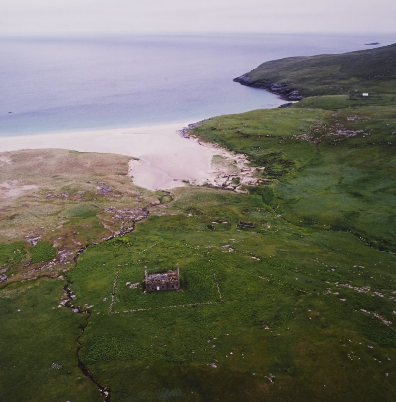 General oblique aerial view centred on the remains of the chapel house and enclosure with the remains of the township, chapel and graveyard and the school and schoolroom adjacent, taken from the NW.