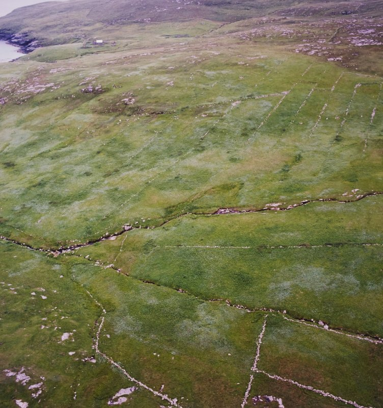 General oblique aerial view of the remains of the crofting strips, head-dykes and field enclosures, taken from the N.