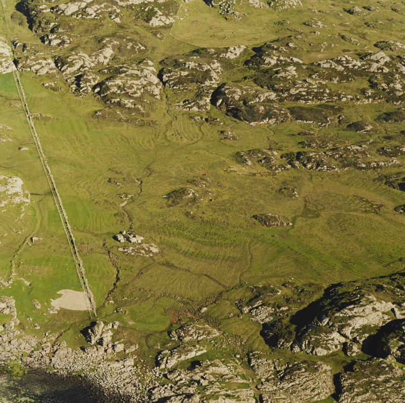 Oblique aerial view of Cnoc Urrais, taken from the north west, centred on field with rig.