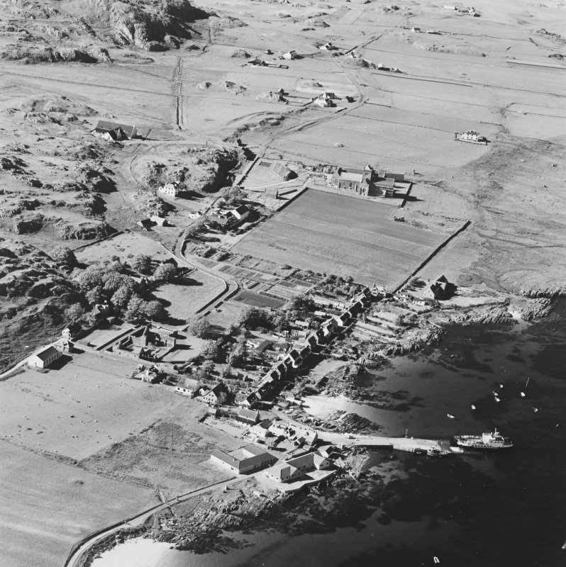 Oblique aerial view of Iona, taken from the south east, centred on the town.