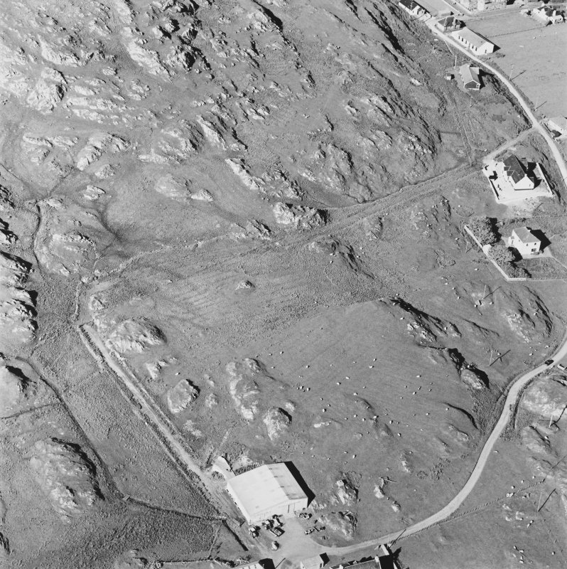 Oblique aerial view of Maol, taken from the south, centred on field with rig.
