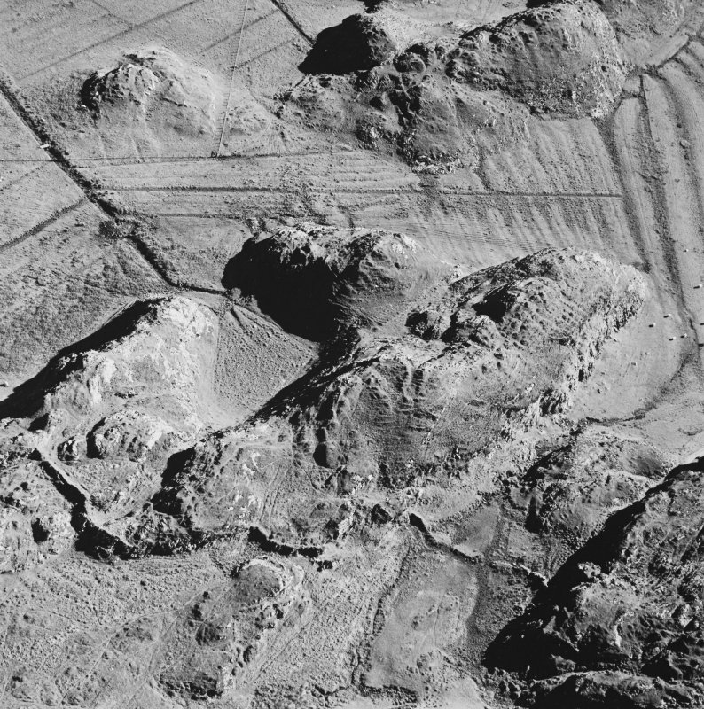 Oblique aerial view of Culbuirg, taken from the north east, centred on rig and field system.