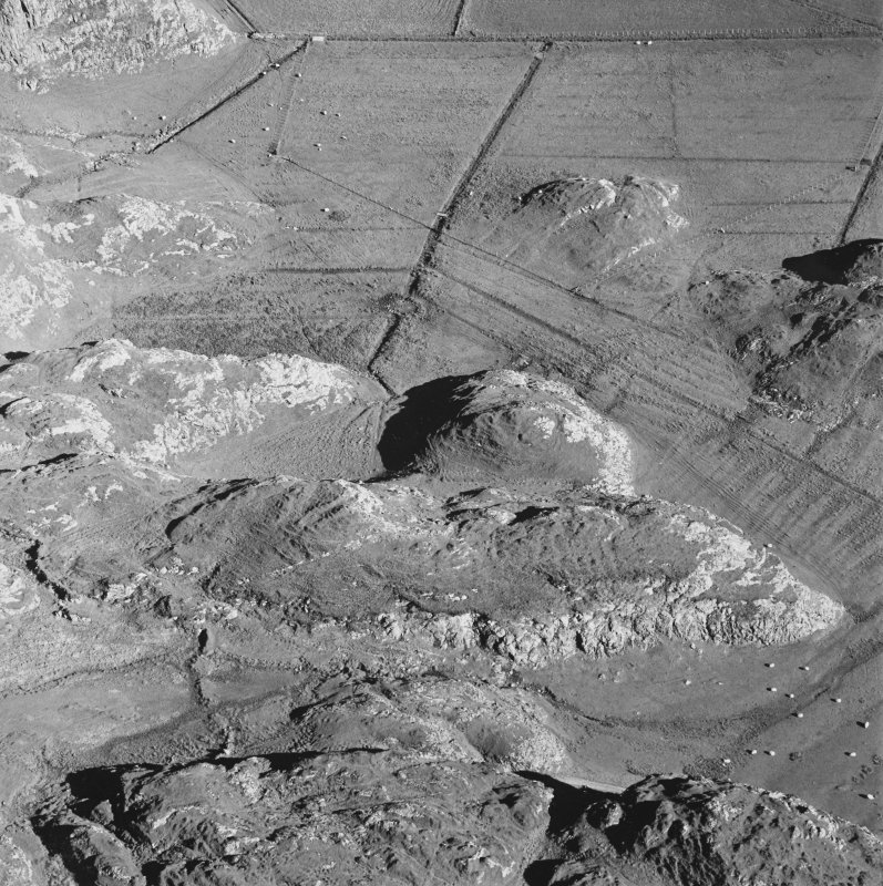 Oblique aerial view of Culbuirg, taken from the north, centred on rig and field system.