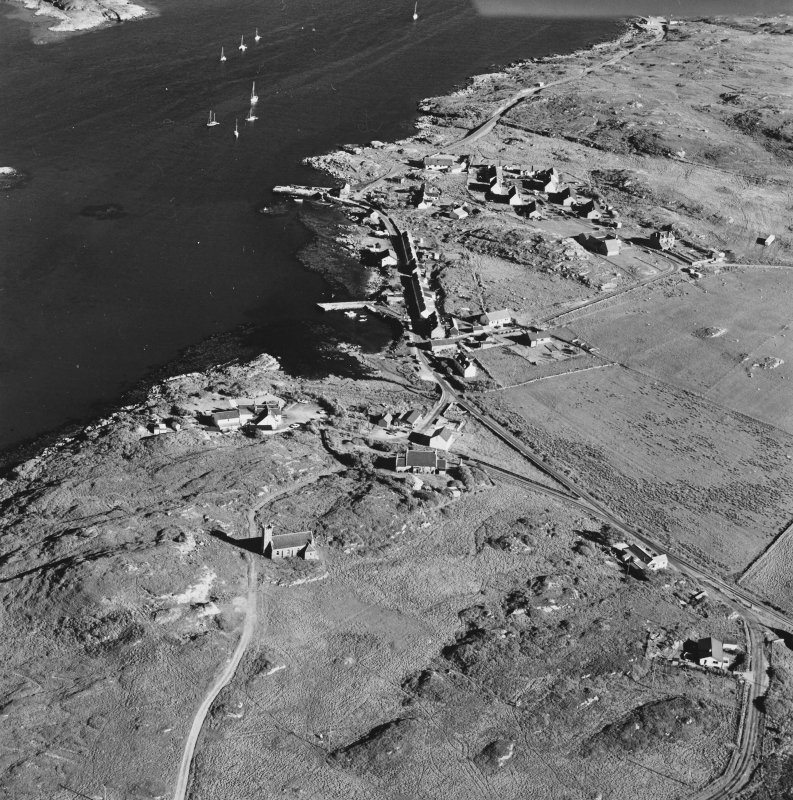 Oblique aerial view of Coll Parish Church, taken from the north west, centred on the church.