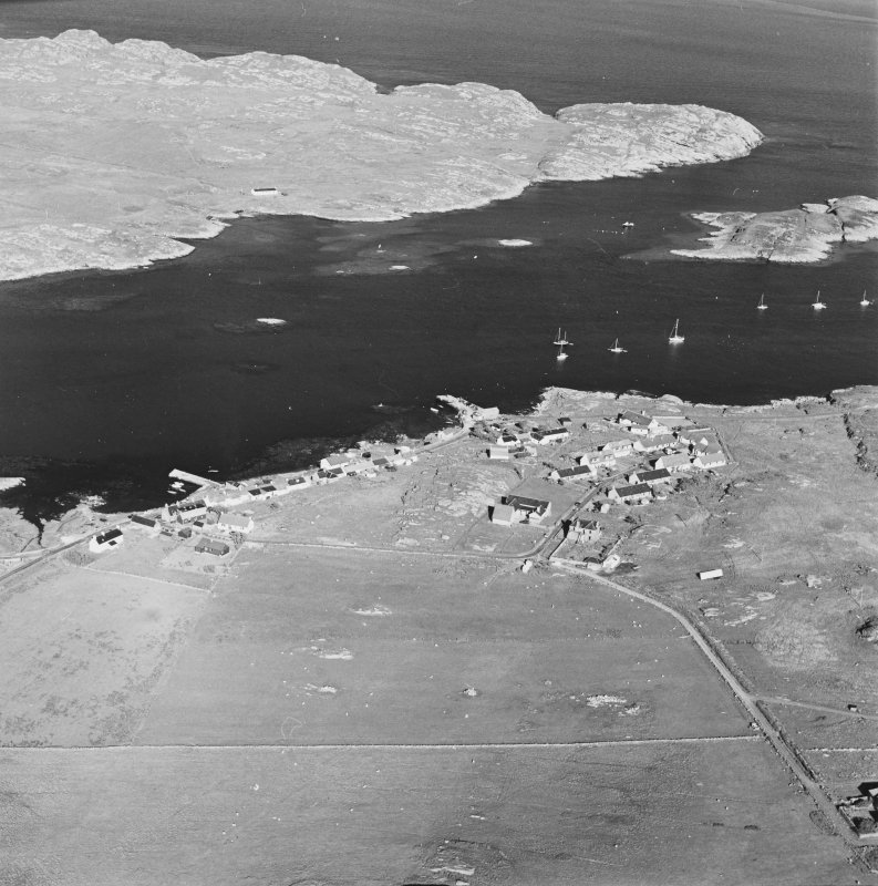 Oblique aerial view of Arinagour, taken from the north west, centred on the town.