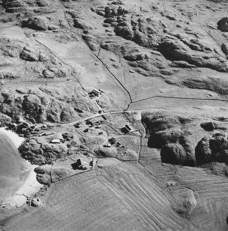 Oblique aerial view of Sorisdale, taken from the north, centred on the cottages.