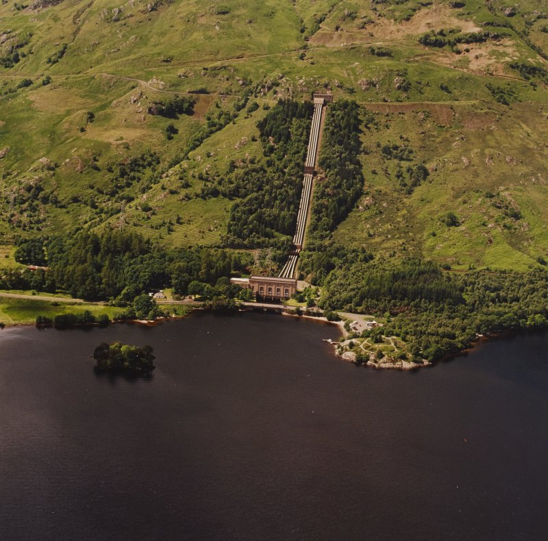 Oblique aerial view of Inveruglas centred on Loch Sloy Hydro-Electric Power Station, taken from the ESE.