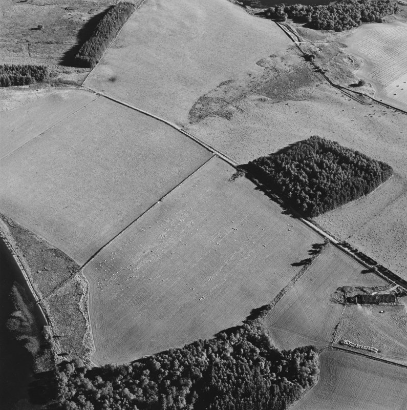 Oblique aerial view centred on the platform of the Roman fort, taken from the N.