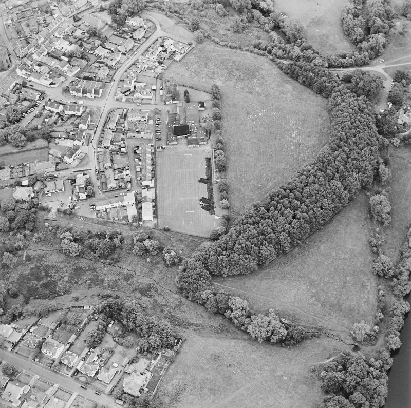 Oblique aerial view centred on the excavations of the Roman fort and possible annexe, taken from the W.