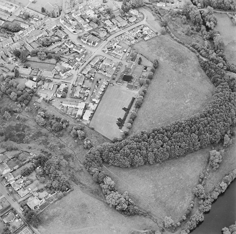Oblique aerial view centred on the excavations of the Roman fort and possible annexe, taken from the WSW.