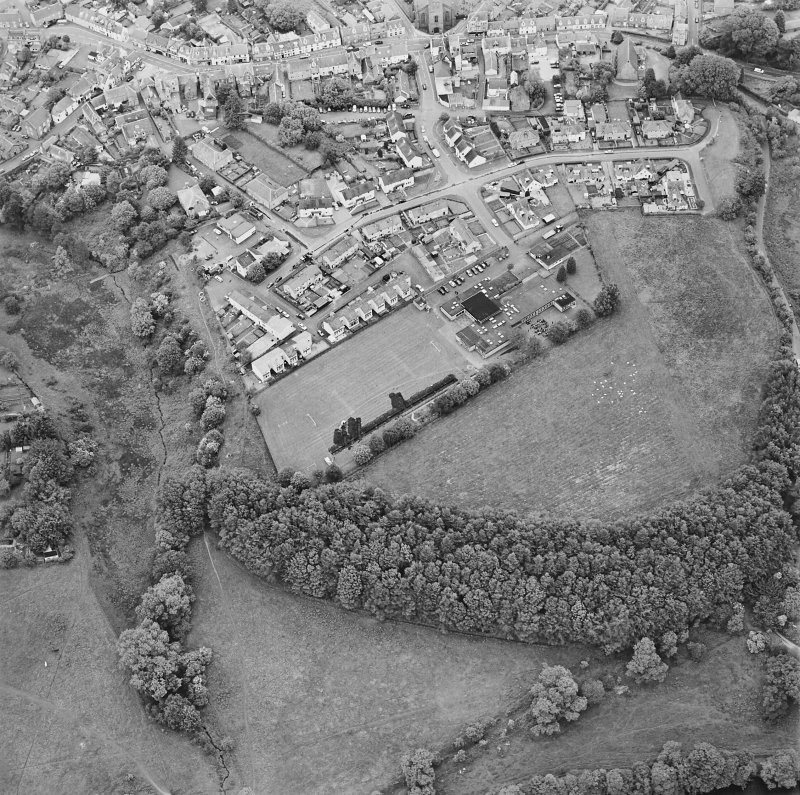 Oblique aerial view centred on the excavations of the Roman fort and possible annexe, taken from the SW.