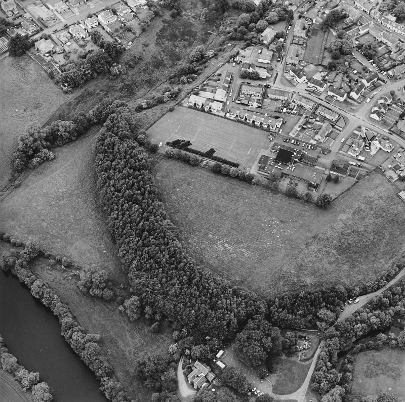 Oblique aerial view centred on the excavations of the Roman fort and possible annexe, taken from the SE.