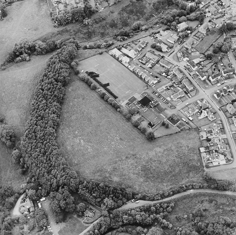Oblique aerial view centred on the excavations of the Roman fort and possible annexe, taken from the ESE.
