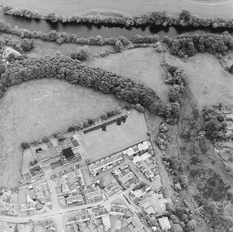 Oblique aerial view centred on the excavations of the Roman fort and possible annexe, taken from the N.