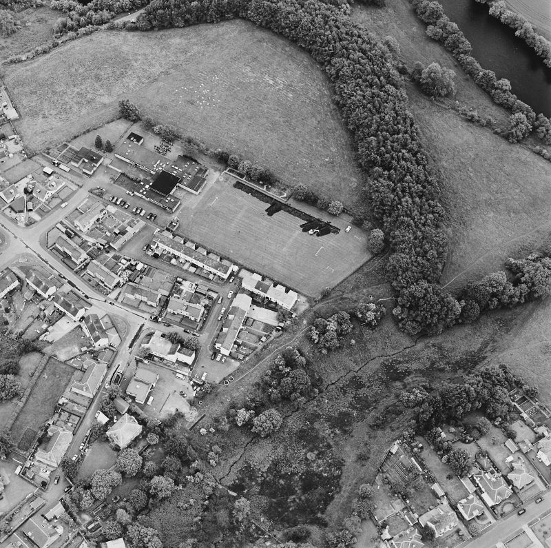 Oblique aerial view centred on the excavations of the Roman fort and possible annexe, taken from the NW.