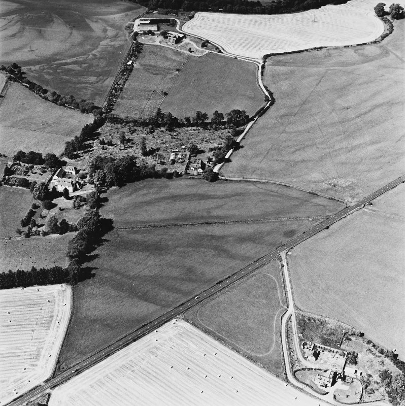 Tullichettle, oblique aerial view, taken from the SE, centred on the cropmarks of an old road, and a pit-defined cursus monument. Dalginross Roman Temporary Camp is visible in the top half of the photograph.