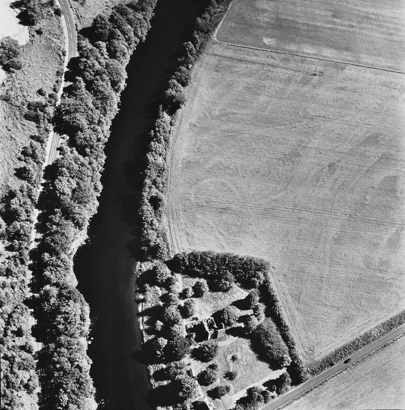 Comrie Castle, oblique aerial view, taken from the WNW, centred on cropmarks including those of an enclosure. Comrie Castle is visible in the bottom half of the photograph.