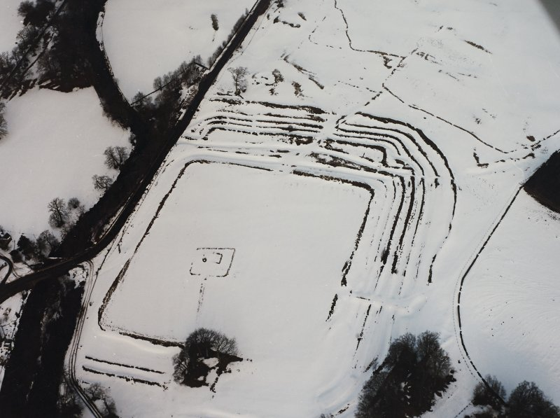 Oblique aerial view centred on fort under cover of snow.