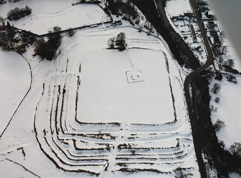 Oblique aerial photograph centred on fort under cover of snow.
