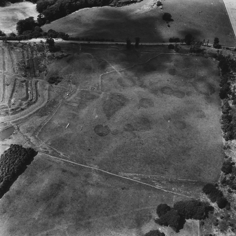 Oblique aerial view from east, centred on temporary camp.