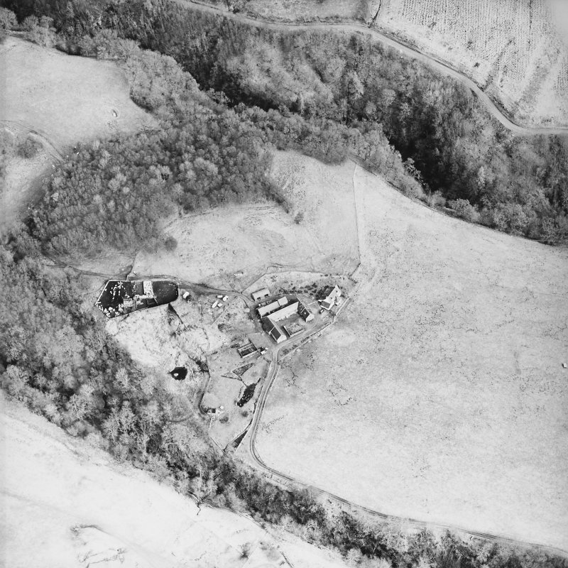Oblique aerial view centred on the farmstead and the remains of the township, taken from the SW.