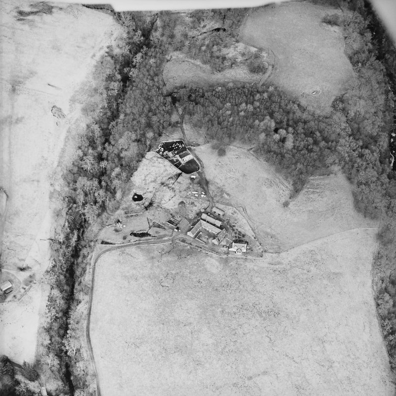 Oblique aerial view centred on the farmstead and the remains of the township, taken from the S.
