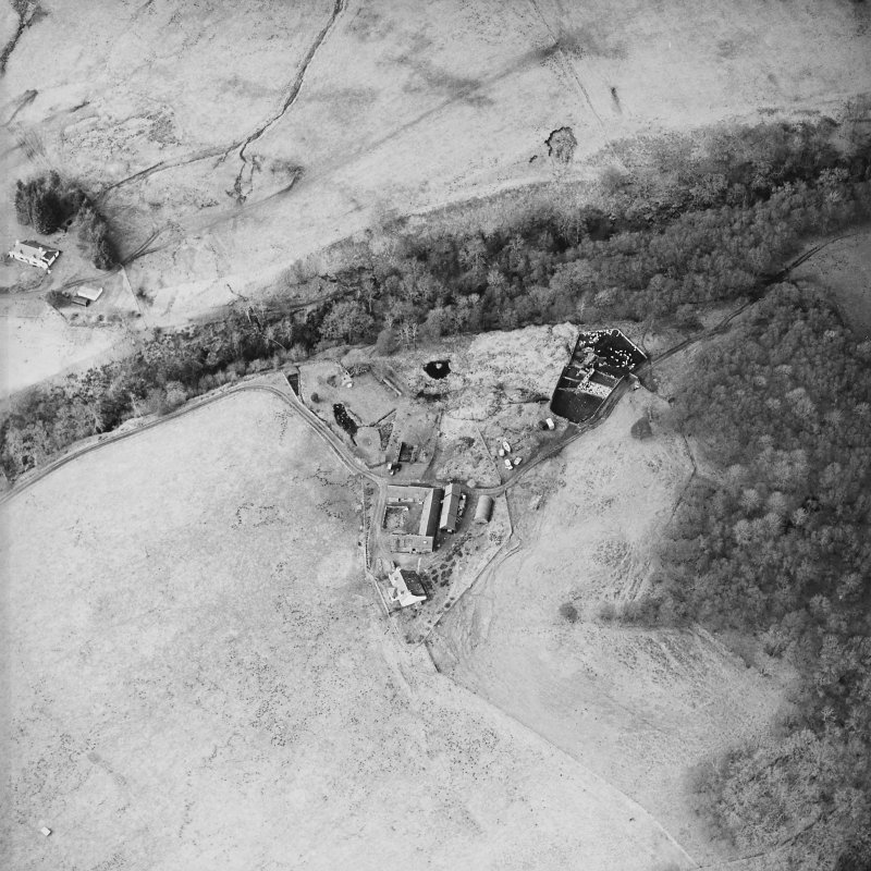 Oblique aerial view centred on the farmstead and the remains of the township, taken from the SE.