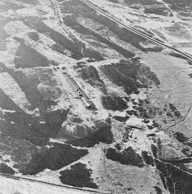 Oblique aerial view of Sheriff Muir centred on the remains of the Atlantic Wall, depot and tramway, taken from the ENE.