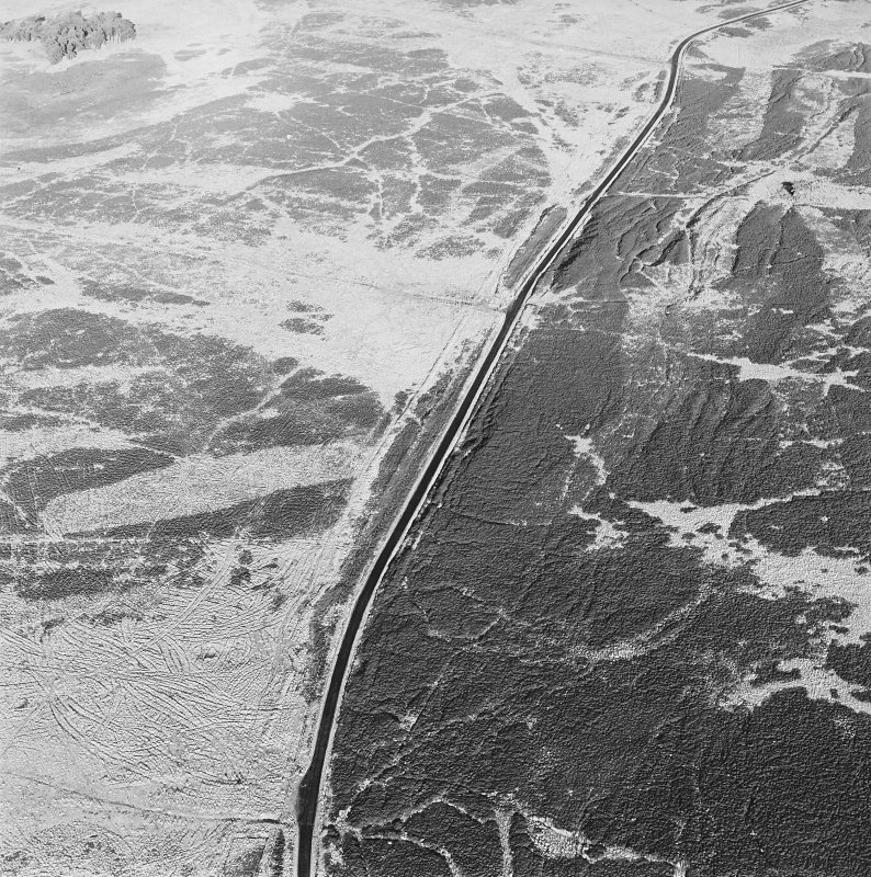 Oblique aerial view of Sheriff Muir centred on trackways, gun-emplacements, bunkers and trenches, taken from the S.