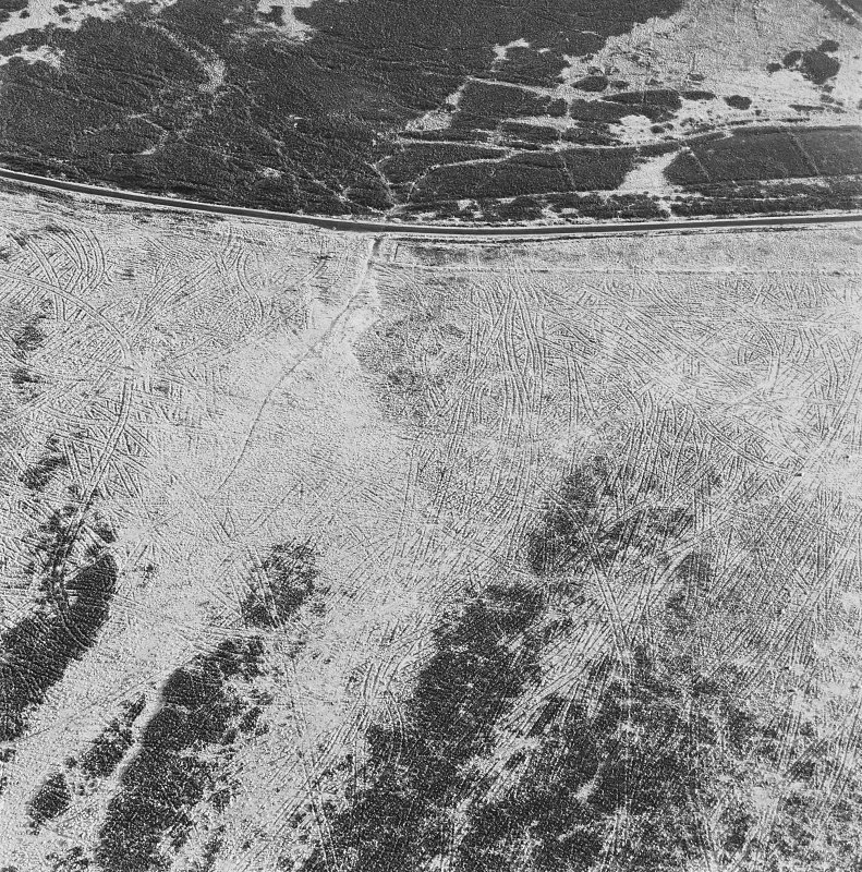 Oblique aerial view of Sheriff Muir centred on trackways, gun-emplacements, bunkers and trenches, taken from the N.