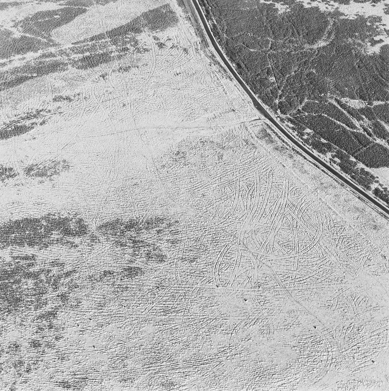 Oblique aerial view of Sheriff Muir centred on trackways, gun-emplacements, bunkers and trenches, taken from the SE.