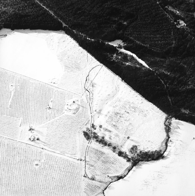 Oblique aerial view centred on the remains of the homestead and field-system, with the remains of the hut-circle, homestead, and building adjacent, taken from the E.