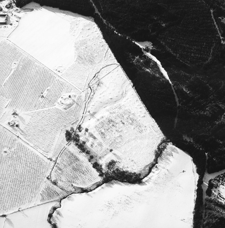 Oblique aerial view centred on the remains of the homestead and field-system, with the remains of the hut-circle, homestead, and building adjacent, taken from the ENE.