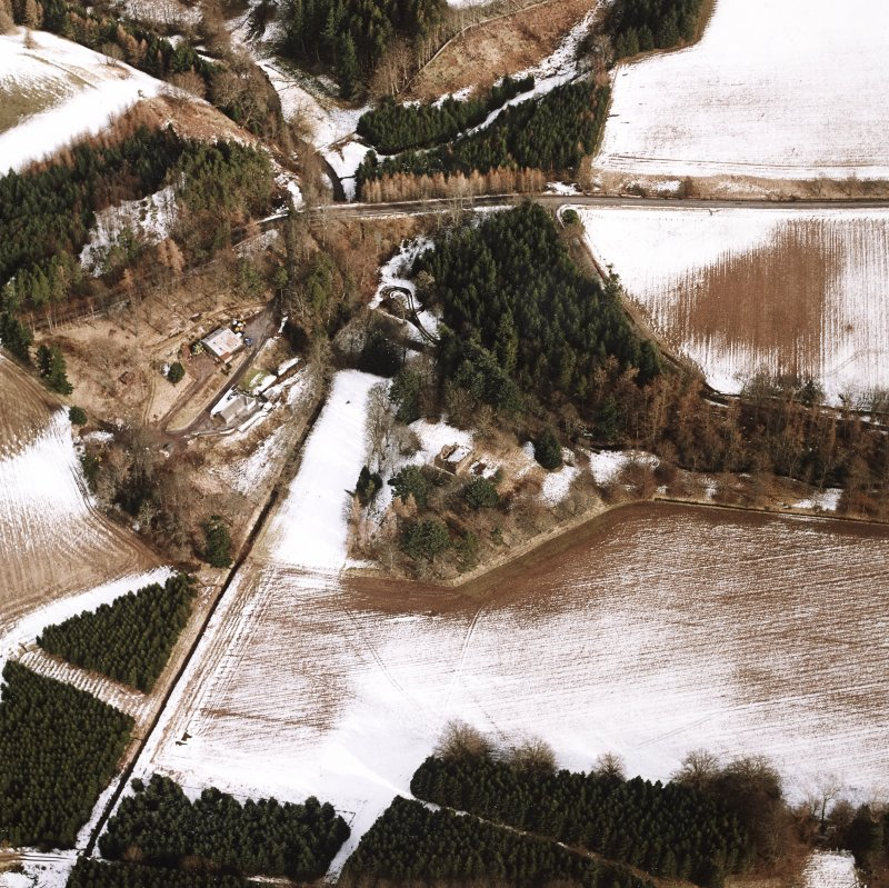 Oblique aerial view centred on the remains of the possible motte and tower-house, taken from the WSW.