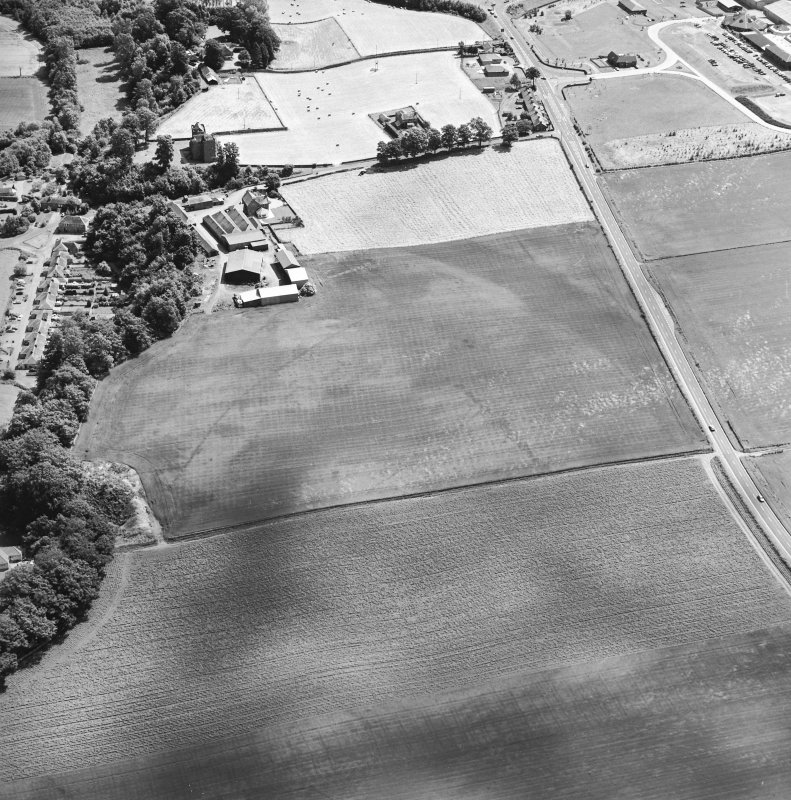 Oblique aerial view centred on the cropmarks of an enclosure, pit-circle, Roman Road, linear cropmarks, pits and pit-alignment with castle adjacent, taken from the WNW.