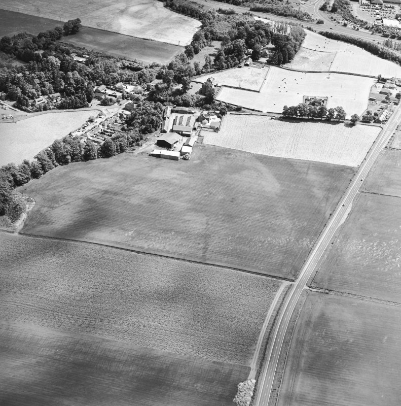 Oblique aerial view centred on the cropmarks of an enclosure, pit-circle, Roman Road, linear cropmarks, pits and pit-alignment with castle adjacent, taken from the WSW.