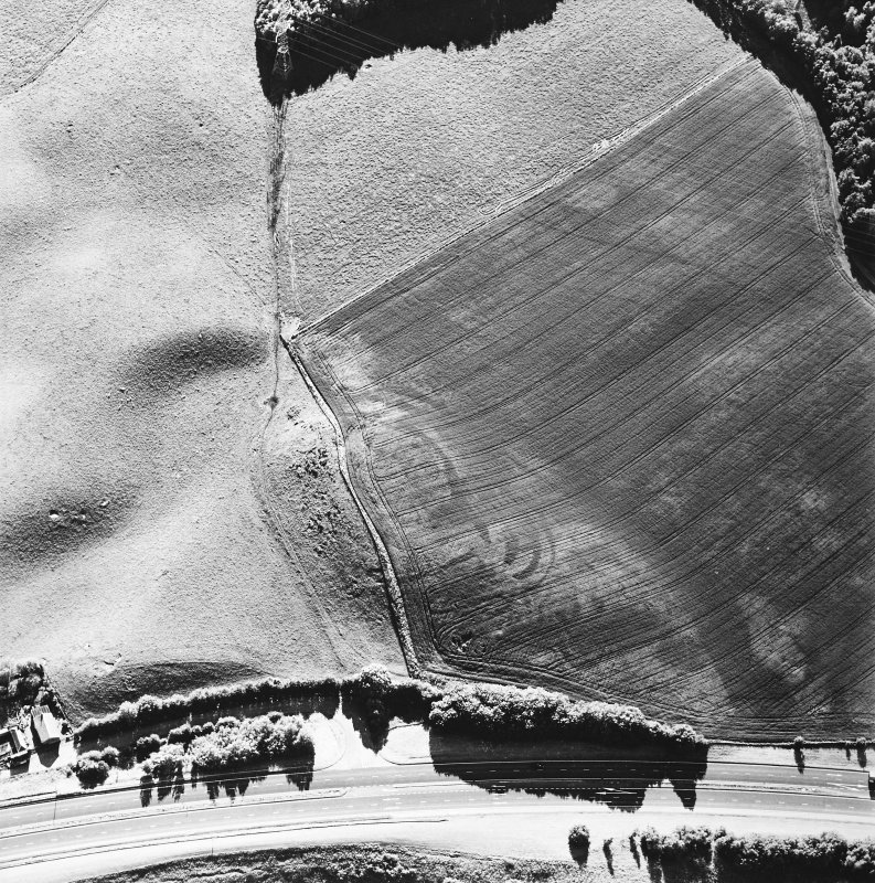 Oblique aerial view of Broxy Kennels centred on the cropmarks of a fort, taken from the E.