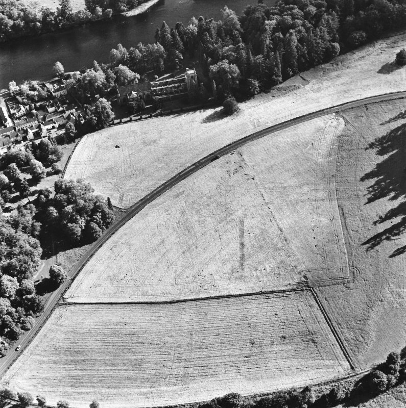 Dunkeld, oblique aerial view, taken from the NNE, centred on the cropmarks of Dunkeld House. Dunkeld Cathedral is visible in the top left-hand corner of the photograph.