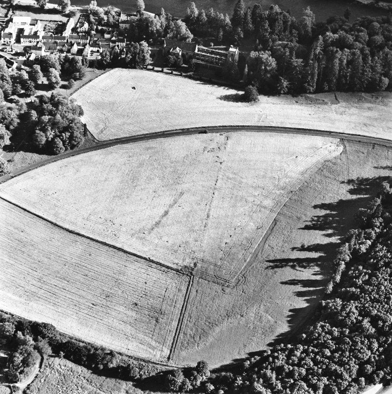 Dunkeld, oblique aerial view, taken from the NNW, centred on the cropmarks of Dunkeld House. Dunkeld Cathedral is visible in the top centre of the photograph.