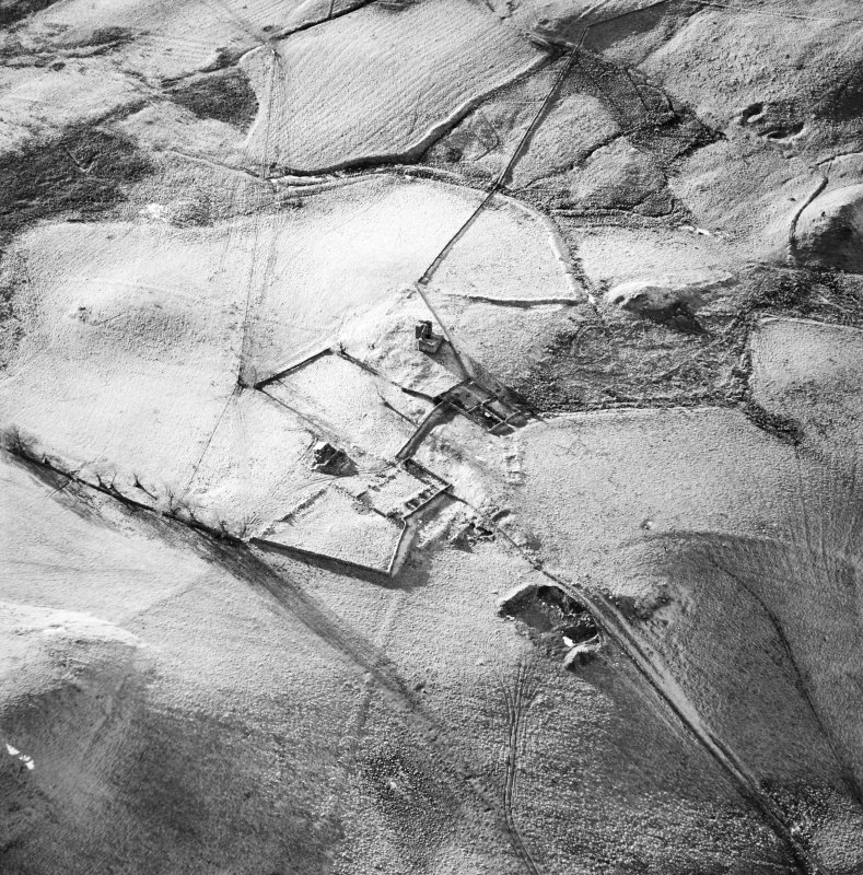 Oblique aerial view centred on the remains of the farmstead, buildings and tower-house, with the remains of the farmstead adjacent, taken from the E.