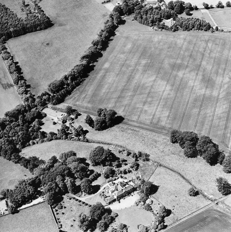 Oblique aerial view centred on the cropmarks of rig and possible timber halls with rectiliear enclosure, field boundaries, ice house, farmsteading, house and country house adjacent, taken from the ESE.