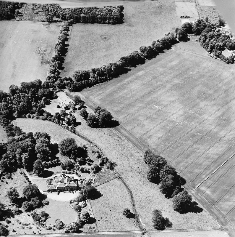 Oblique aerial view centred on the cropmarks of rig and possible timber halls with ice-house, house and country house adjacent, taken from the ENE.