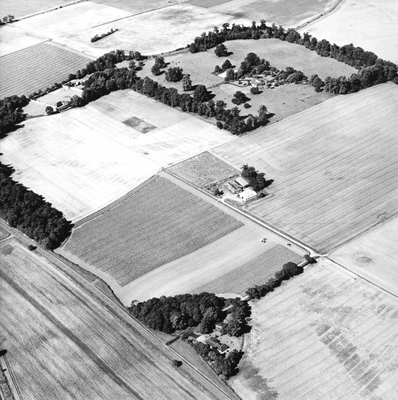 Oblique aerial view centred on the cropmarks of the Roman Fortress, taken from the ESE.