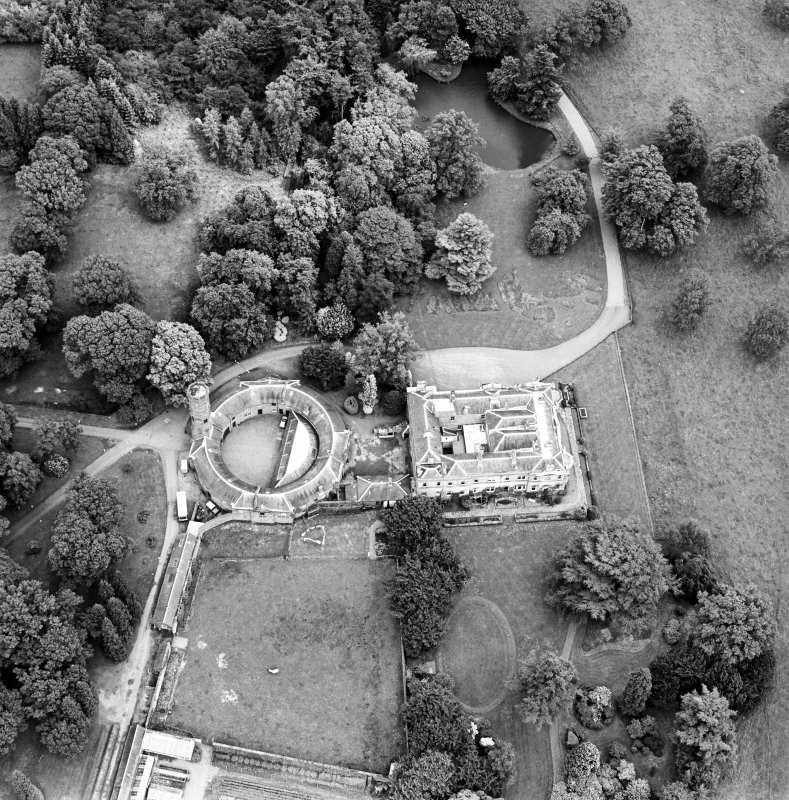 Oblique aerial view centred on the country house, taken from the W.