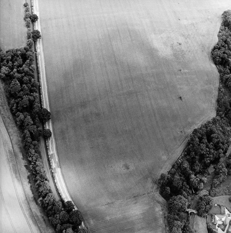 Oblique aerial view centred on the cropmarks of the fort with the bridge adjacent, taken from the WSW.
